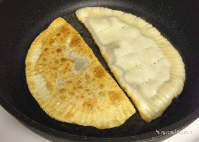 fry chebureki in pan